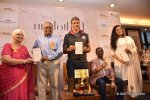 milind-soman-unveiling-the-book-with-the-author-probir-sengupta-sitting-and-publisher-of-the-book_57588671